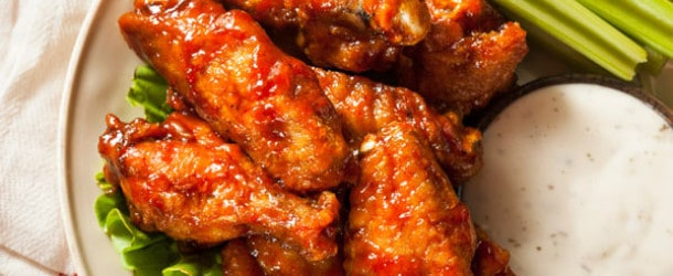 cooked wings with ranch sauce and celery