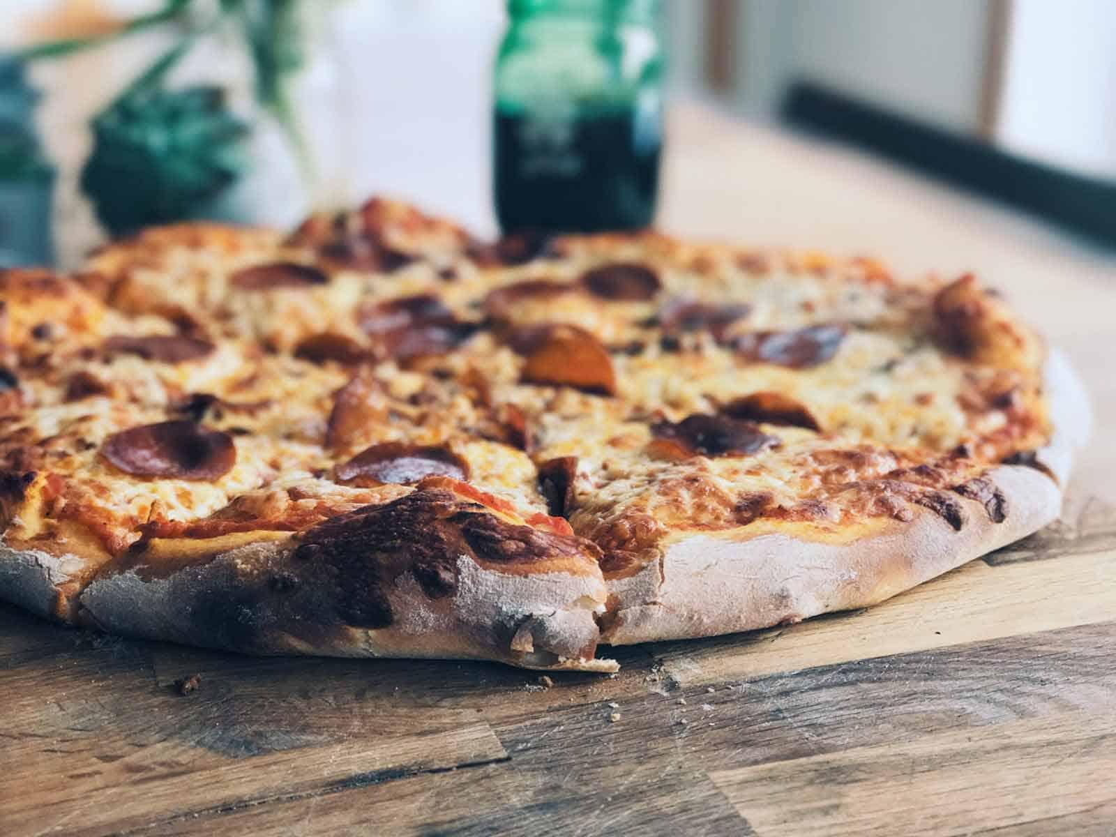 omega pizza on a cutting board